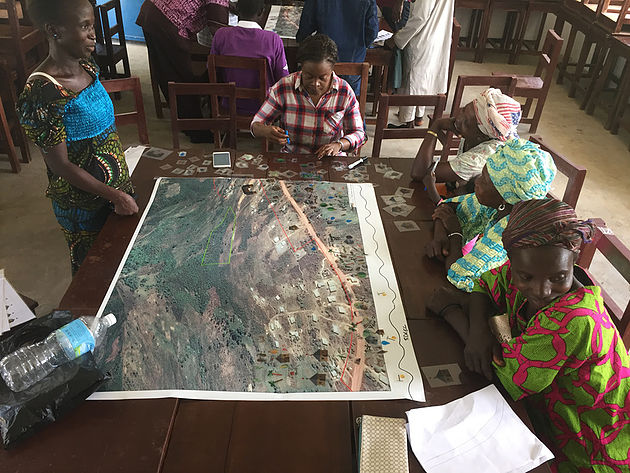 community looking at map